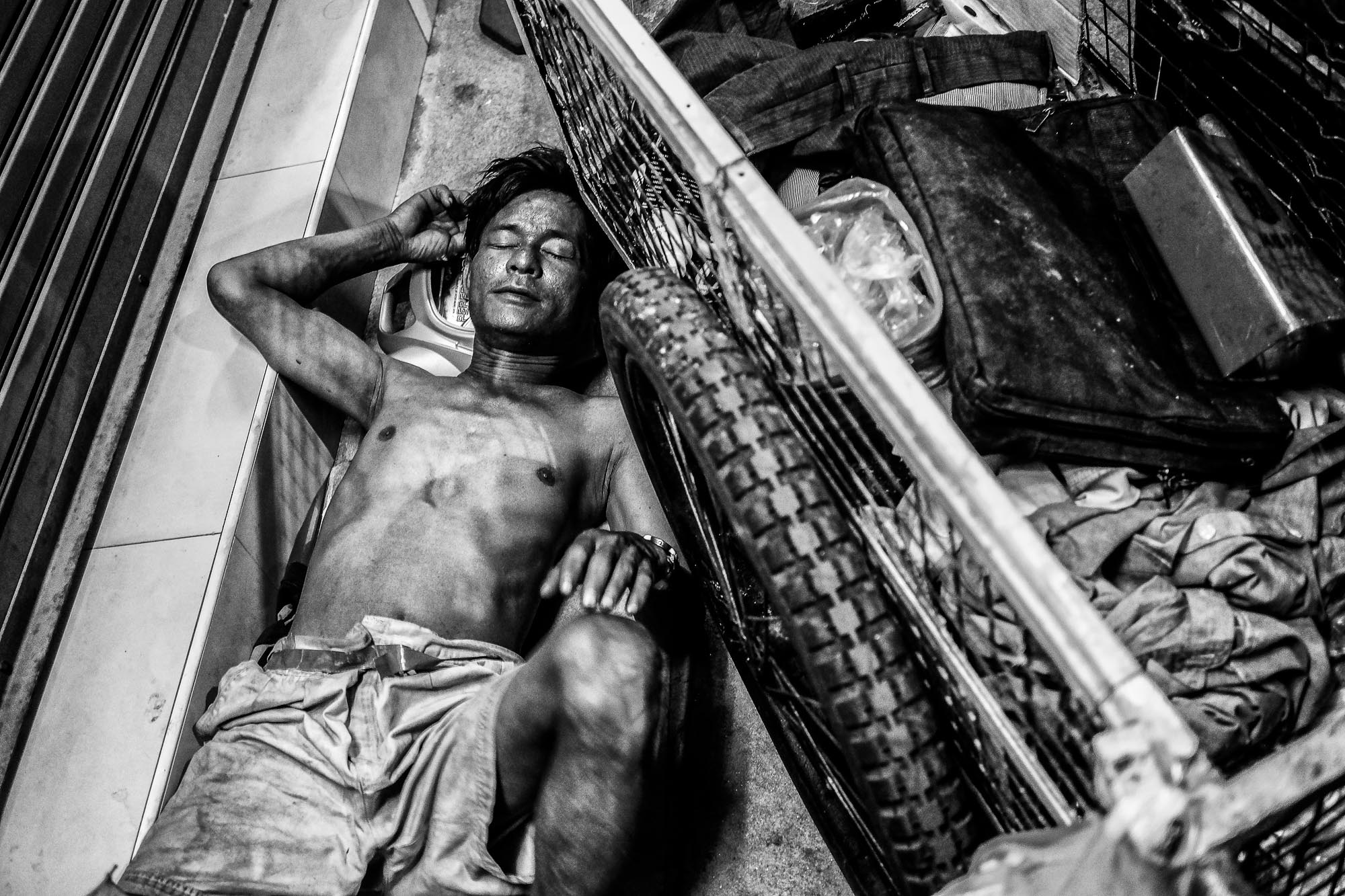 Black and white Bangkok Thailand BKK street photography sleeping man
