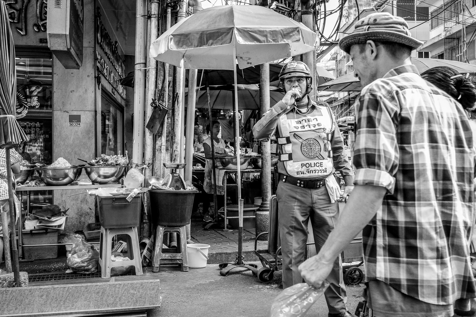 Black and white Bangkok Thailand BKK street photography police