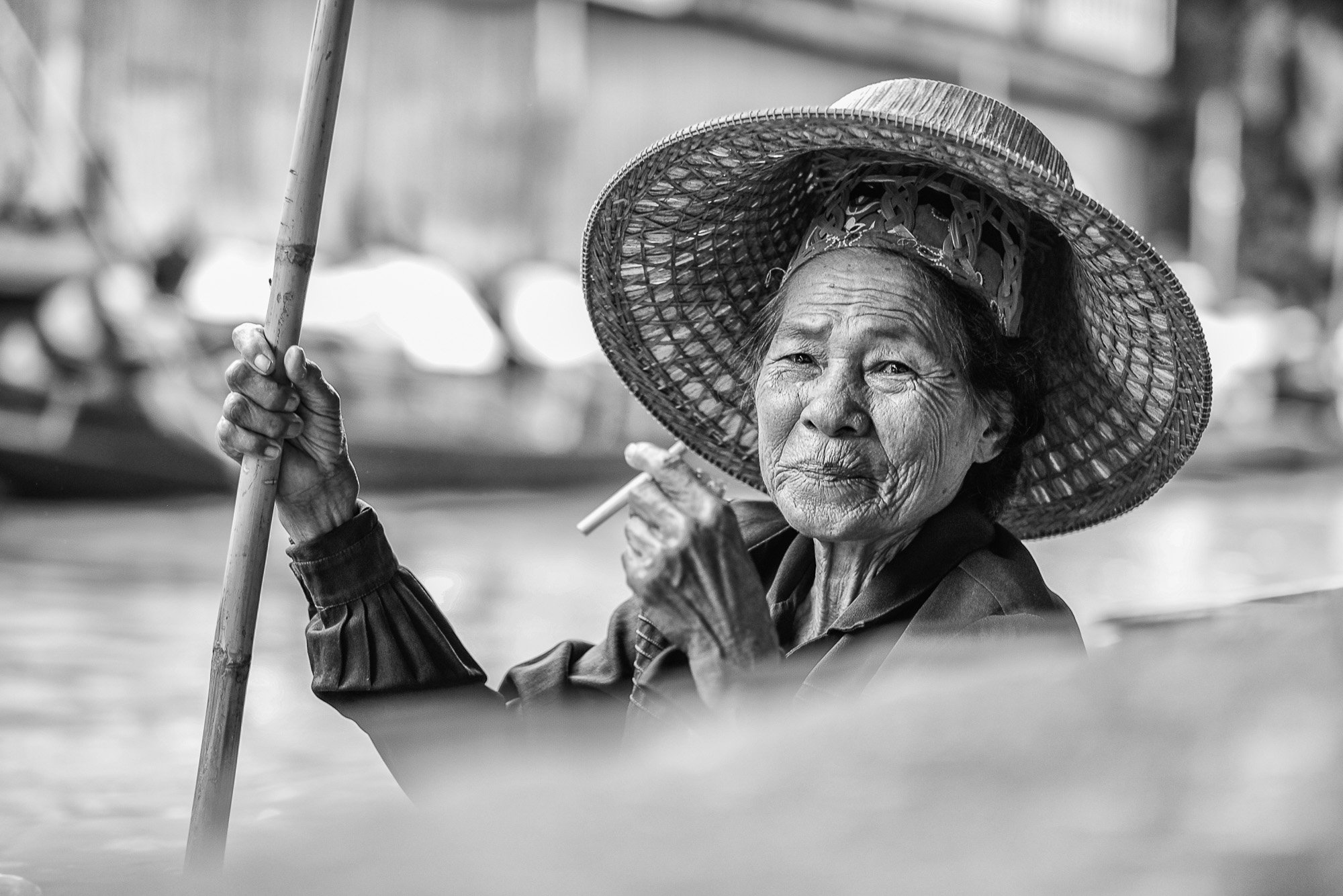 Black and white Bangkok Thailand BKK street photography wait market boat lady smoking