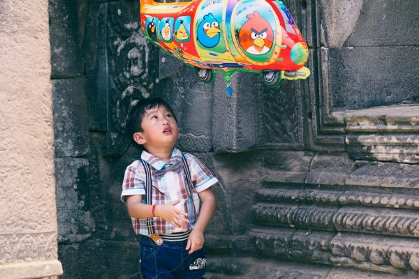 boy balloon angkor wat temple SIEM REAP cambodia asia street photography