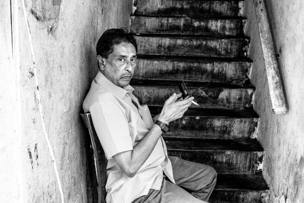 man smoking little india SINGAPORE sg street photography photographer asia