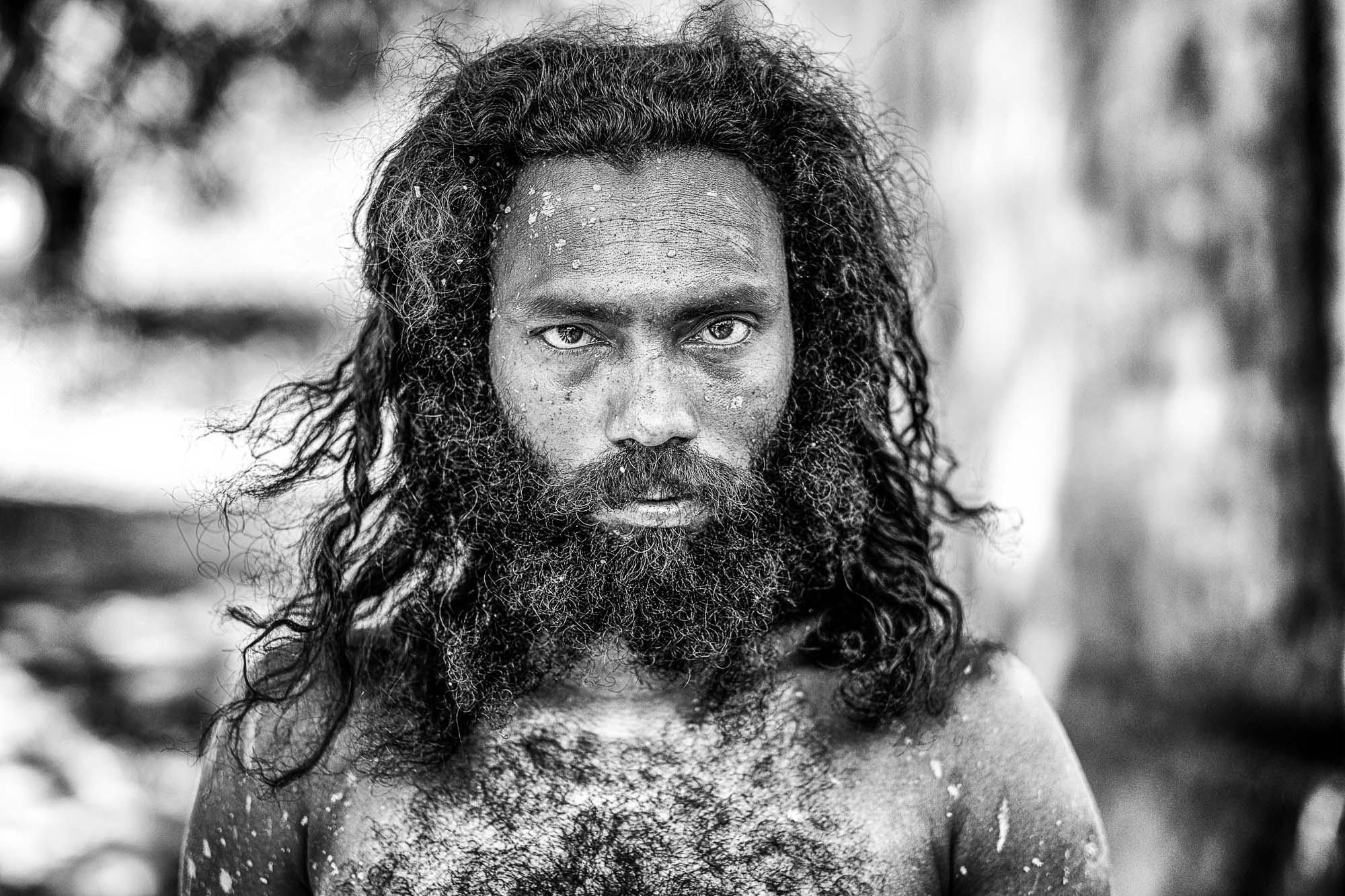 Vadda sri lanka indingenous group people - veddas portrait photography man beard long hair