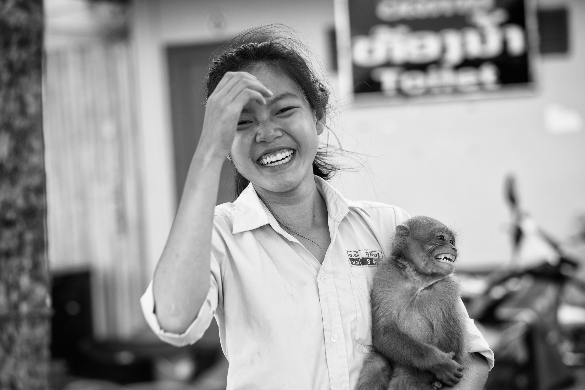 little girl smile monkey VIENTIANE Laos asia street photography photographer