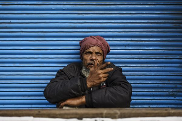 Man Blue wall India New Delhi street photography Photographer Jose Jeuland FUJIFILM GFX50R travel