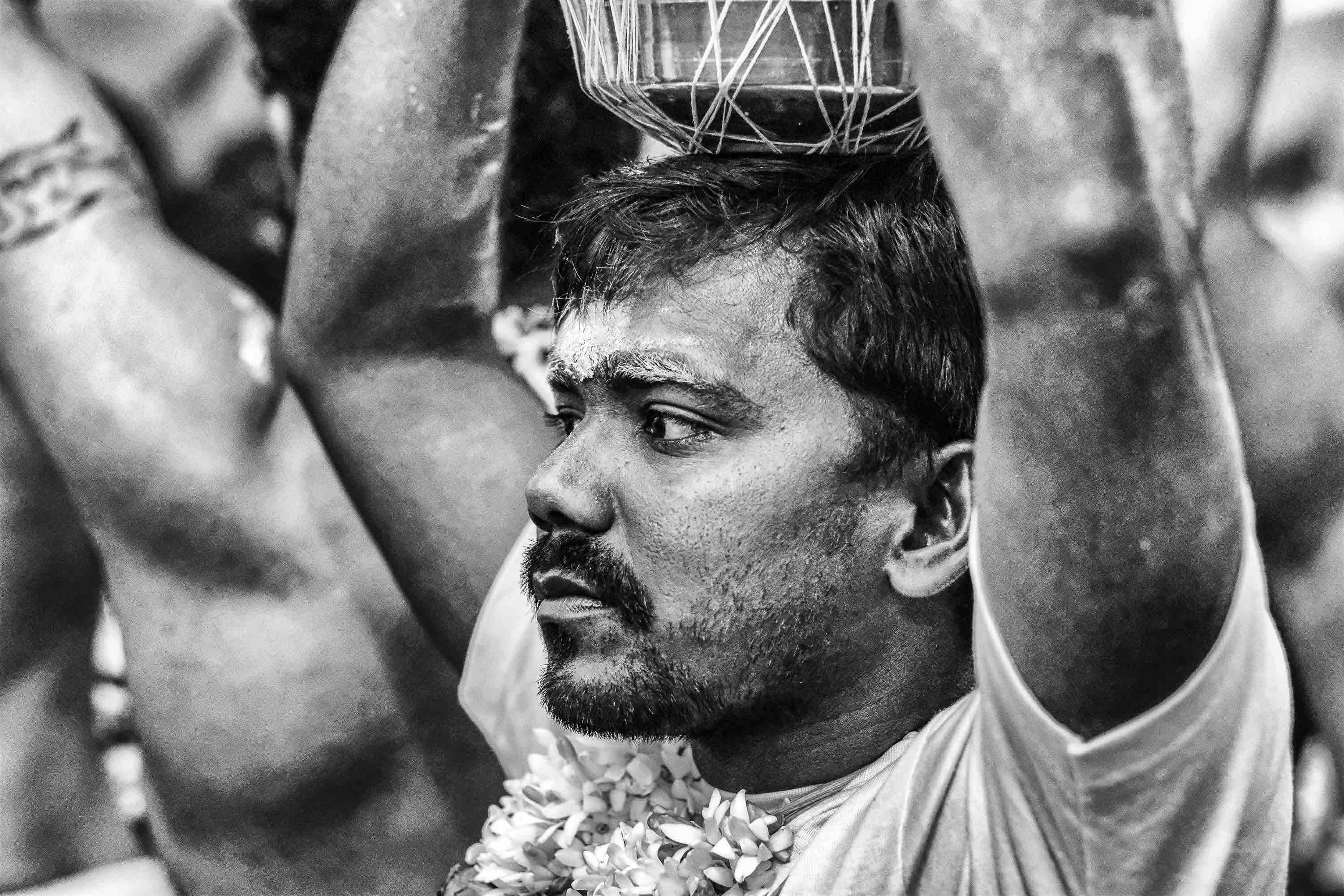 man ready wilk pot on the head Little India Thaipusam Festival hindu Singapore photography jose jeuland documentary event
