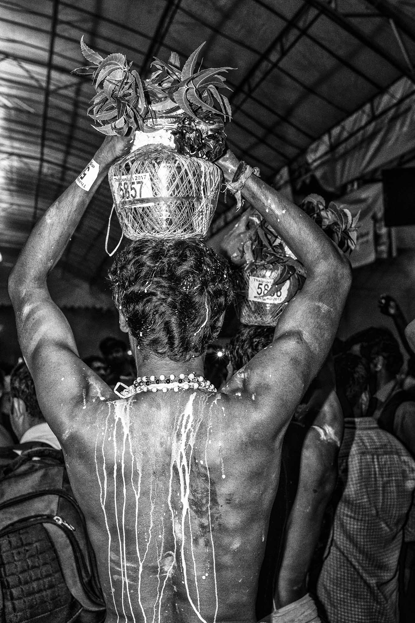 milk pot head walking Little India Thaipusam Festival hindu Singapore photography jose jeuland documentary event