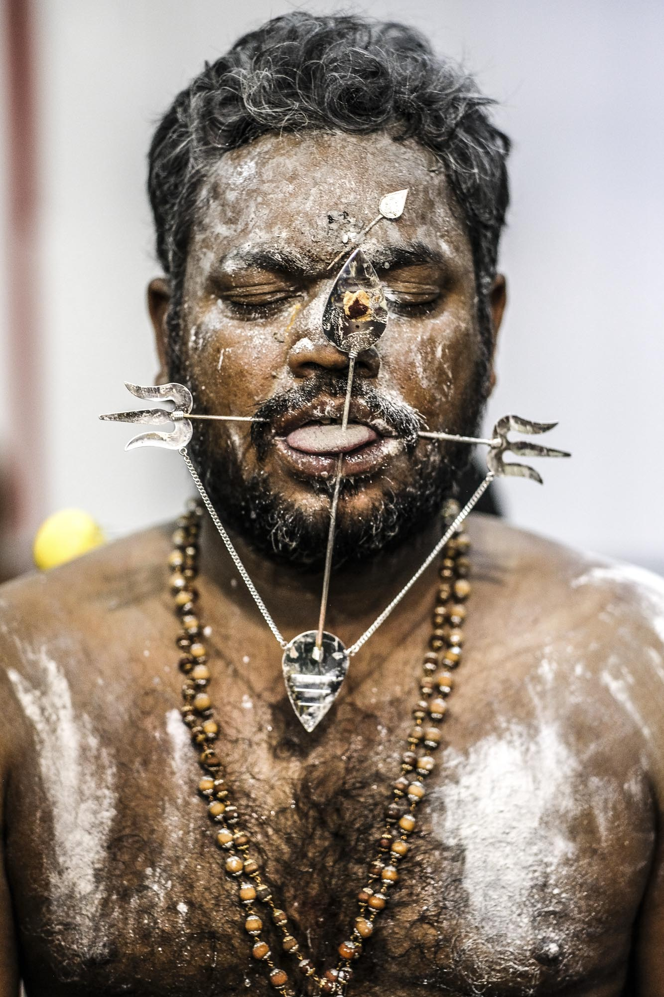 tongue piercing white poder Little India Thaipusam Festival hindu Singapore photography jose jeuland documentary event