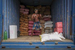 colombo Sri Lanka man working Commercial Editorial Portraiture Documentary Photographer fujifilm Director Singapore Jose Jeuland photography fashion
