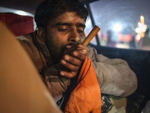 smoking weed smoke man pilgrims Kumbh mela 2019 India Allahabad Prayagraj Ardh hindu religious Festival event rivers photographer jose jeuland photography