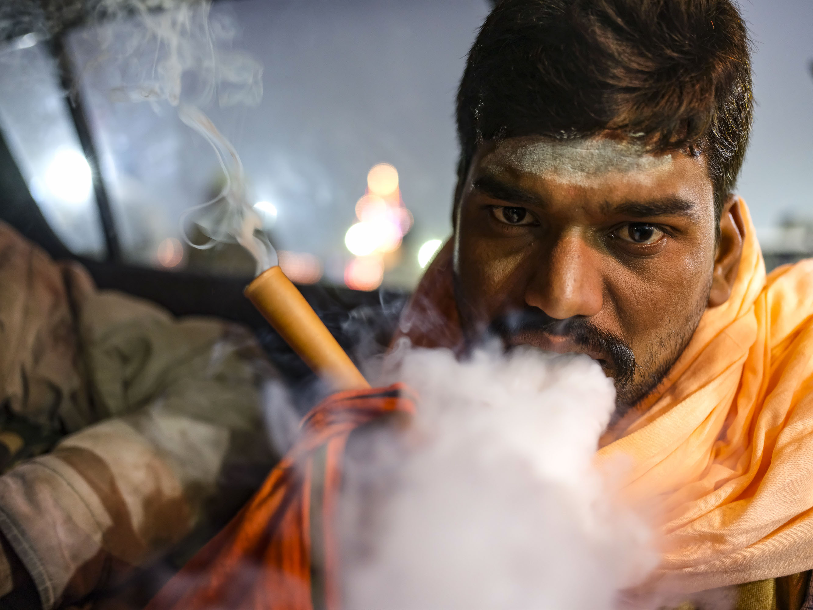 ganja smoke smoking man in car night pilgrims Kumbh mela 2019 India Allahabad Prayagraj Ardh hindu religious Festival event rivers photographer jose jeuland photography
