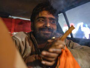 smoking ganja smoke man car pilgrims Kumbh mela 2019 India Allahabad Prayagraj Ardh hindu religious Festival event rivers photographer jose jeuland photography