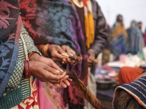 prayer with a tail of a calf pilgrims Kumbh mela 2019 India Allahabad Prayagraj Ardh hindu religious Festival event rivers photographer jose jeuland photography