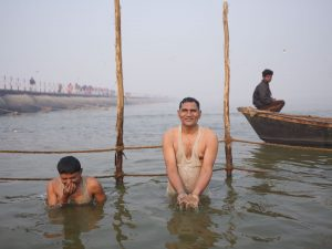 early morning both soil man pilgrims Kumbh mela 2019 India Allahabad Prayagraj Ardh hindu religious Festival event rivers photographer jose jeuland photography