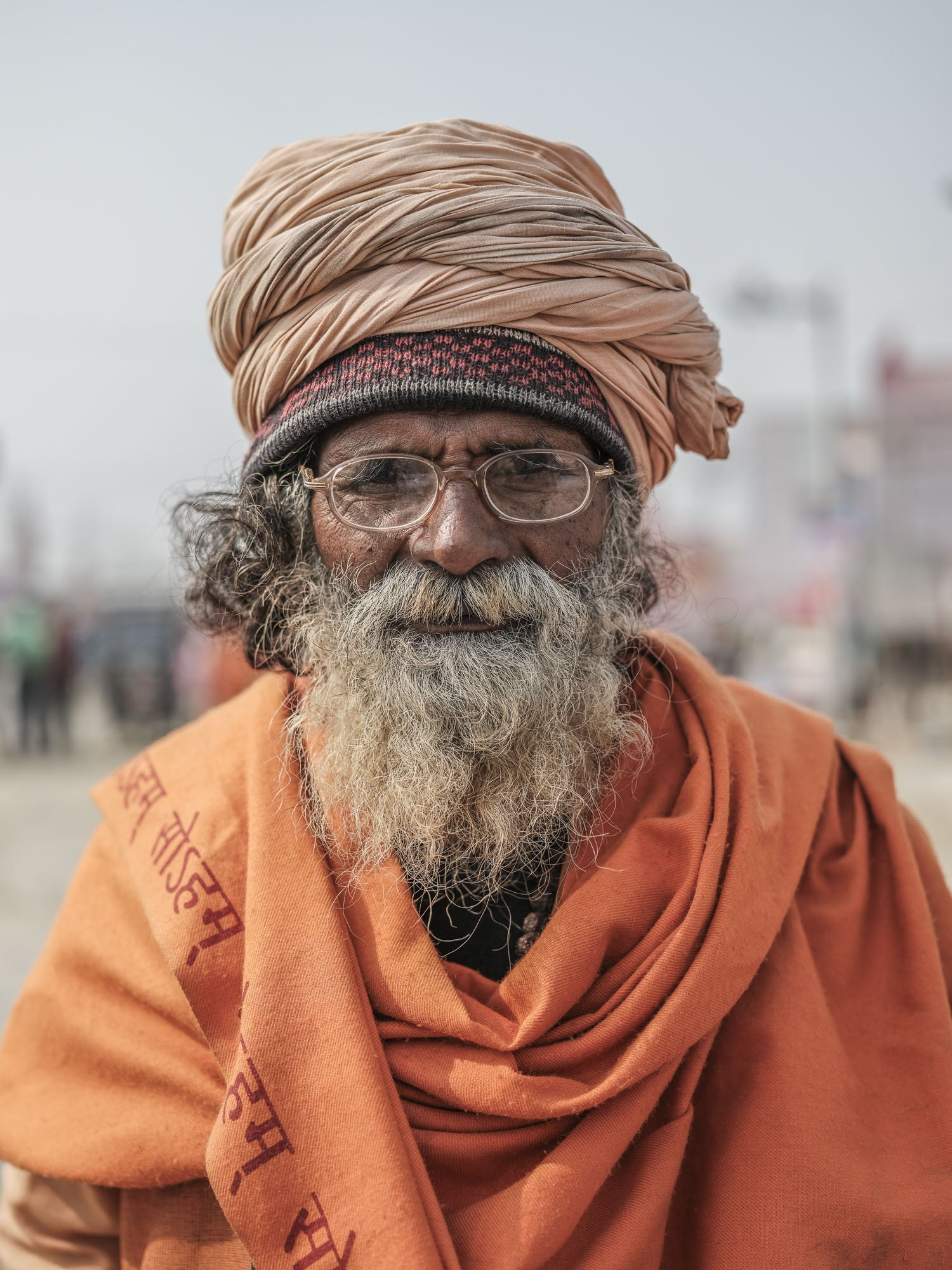 portrait indian man orange pilgrims Kumbh mela 2019 India Allahabad Prayagraj Ardh hindu religious Festival event rivers photographer jose jeuland photography