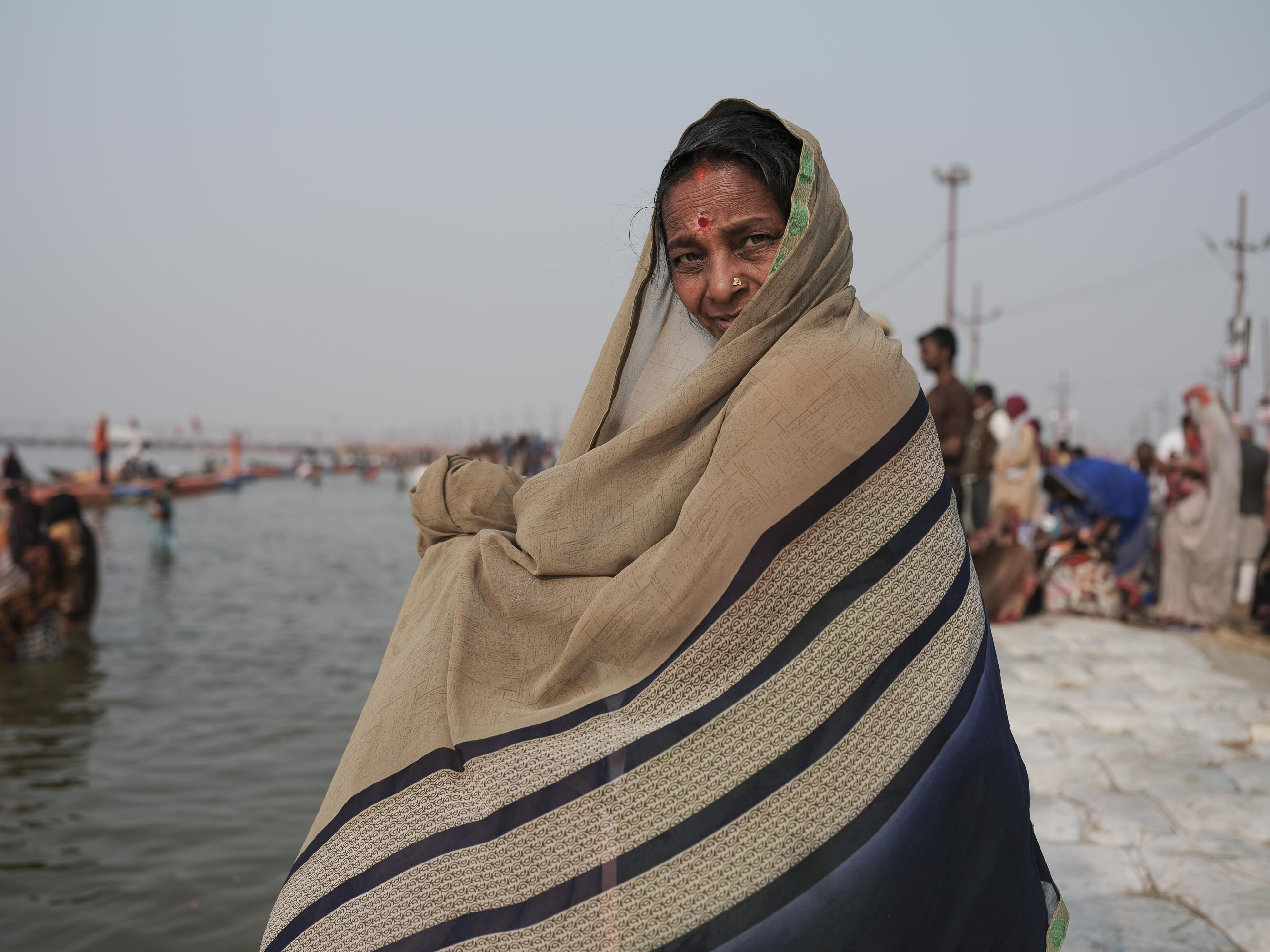 women sari bath pilgrims Kumbh mela 2019 India Allahabad Prayagraj Ardh hindu religious Festival event rivers photographer jose jeuland photography