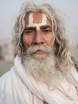 portrait man beard long hair pilgrims Kumbh mela 2019 India Allahabad Prayagraj Ardh hindu religious Festival event rivers photographer jose jeuland photography
