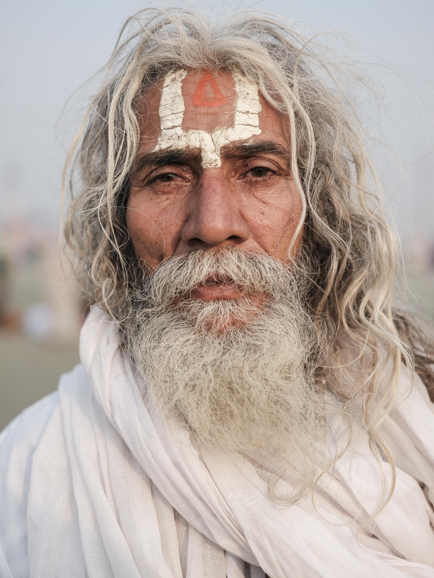 portrait man beard long hair pilgrims Kumbh mela 2019 India Allahabad Prayagraj Ardh hindu religious Festival event rivers photographer jose jeuland photography