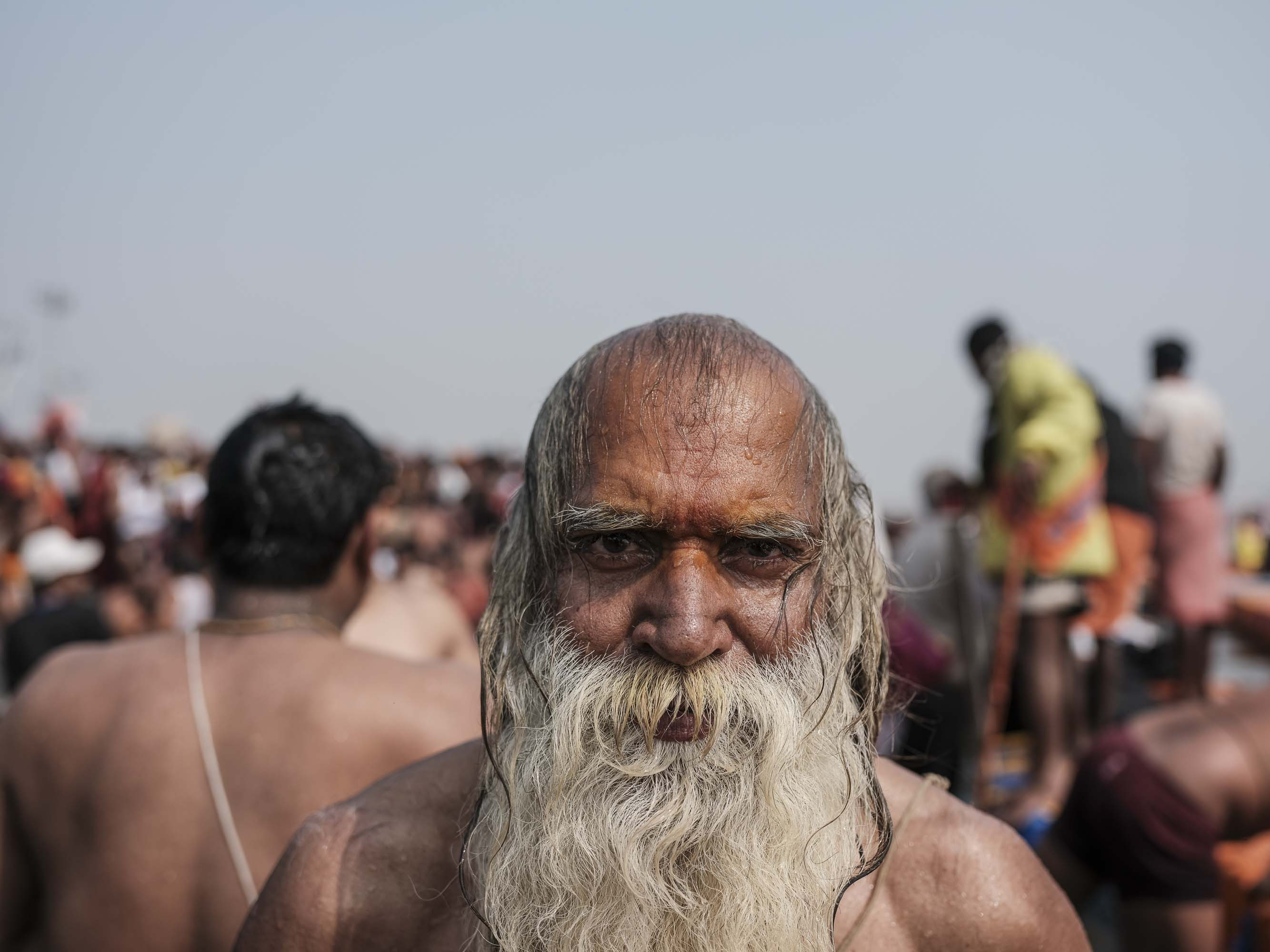 portrait Man crowed pilgrims Kumbh mela 2019 India Allahabad Prayagraj Ardh hindu religious Festival event rivers photographer jose jeuland photography
