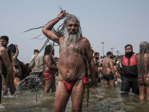 baba long hair in the water pilgrims Kumbh mela 2019 India Allahabad Prayagraj Ardh hindu religious Festival event rivers photographer jose jeuland photography