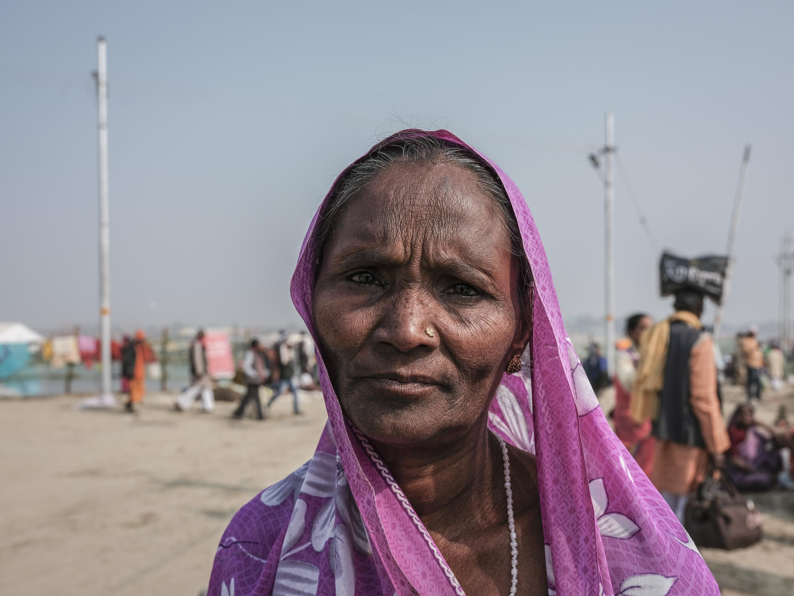 portrait woman color pink fabric pilgrims Kumbh mela 2019 India Allahabad Prayagraj Ardh hindu religious Festival event rivers photographer jose jeuland photography