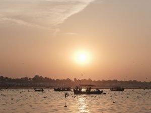 sunset boat pilgrims Kumbh mela 2019 India Allahabad Prayagraj Ardh hindu religious Festival event rivers photographer jose jeuland photography