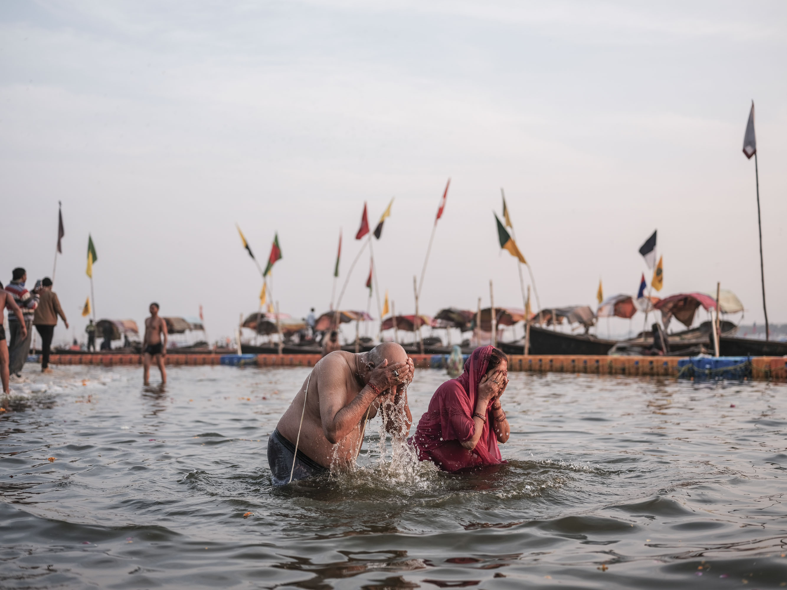 couple old in the water praying pilgrims Kumbh mela 2019 India Allahabad Prayagraj Ardh hindu religious Festival event rivers photographer jose jeuland photography