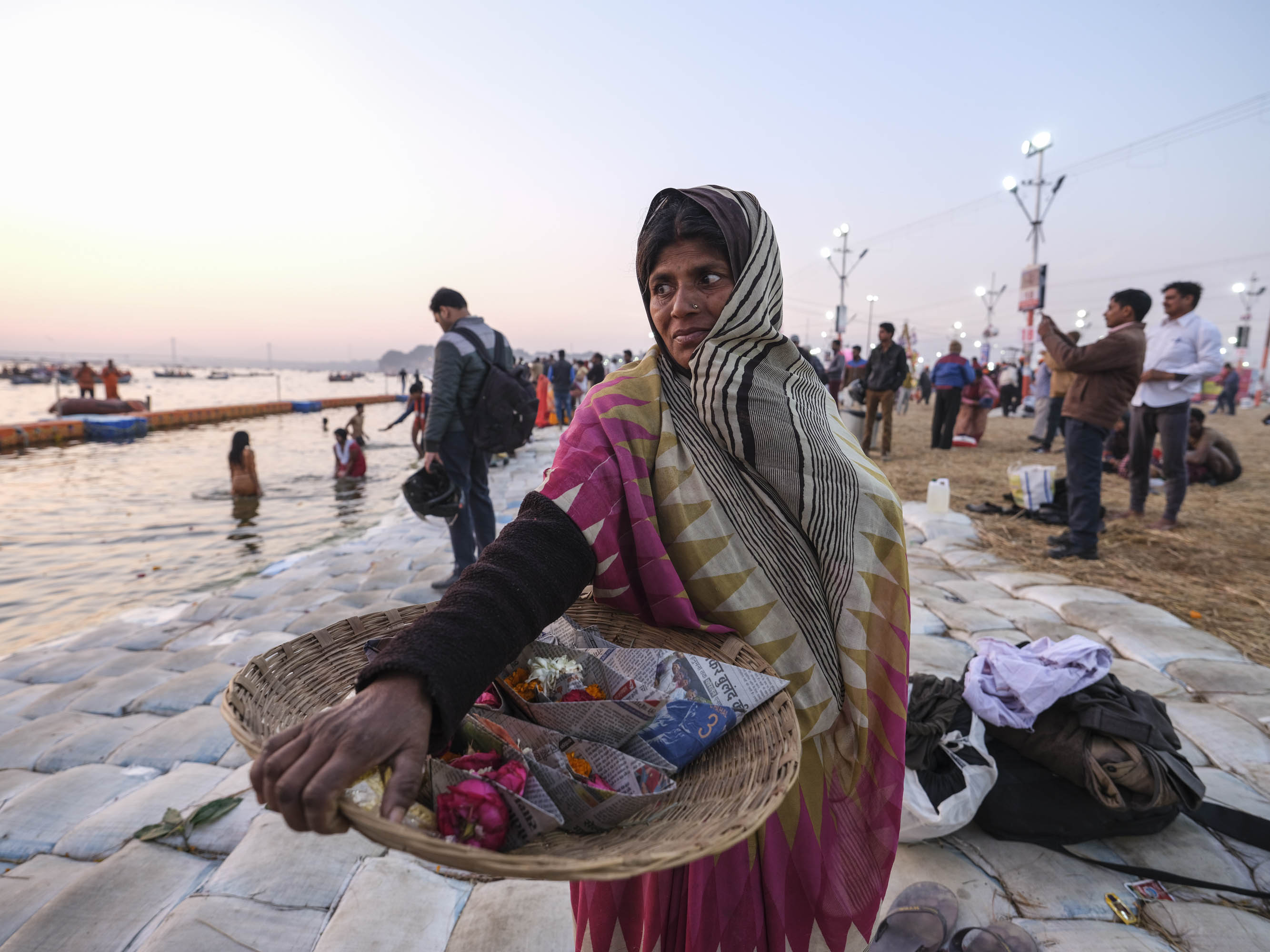 flower by the water bath offering pilgrims Kumbh mela 2019 India Allahabad Prayagraj Ardh hindu religious Festival event rivers photographer jose jeuland photography