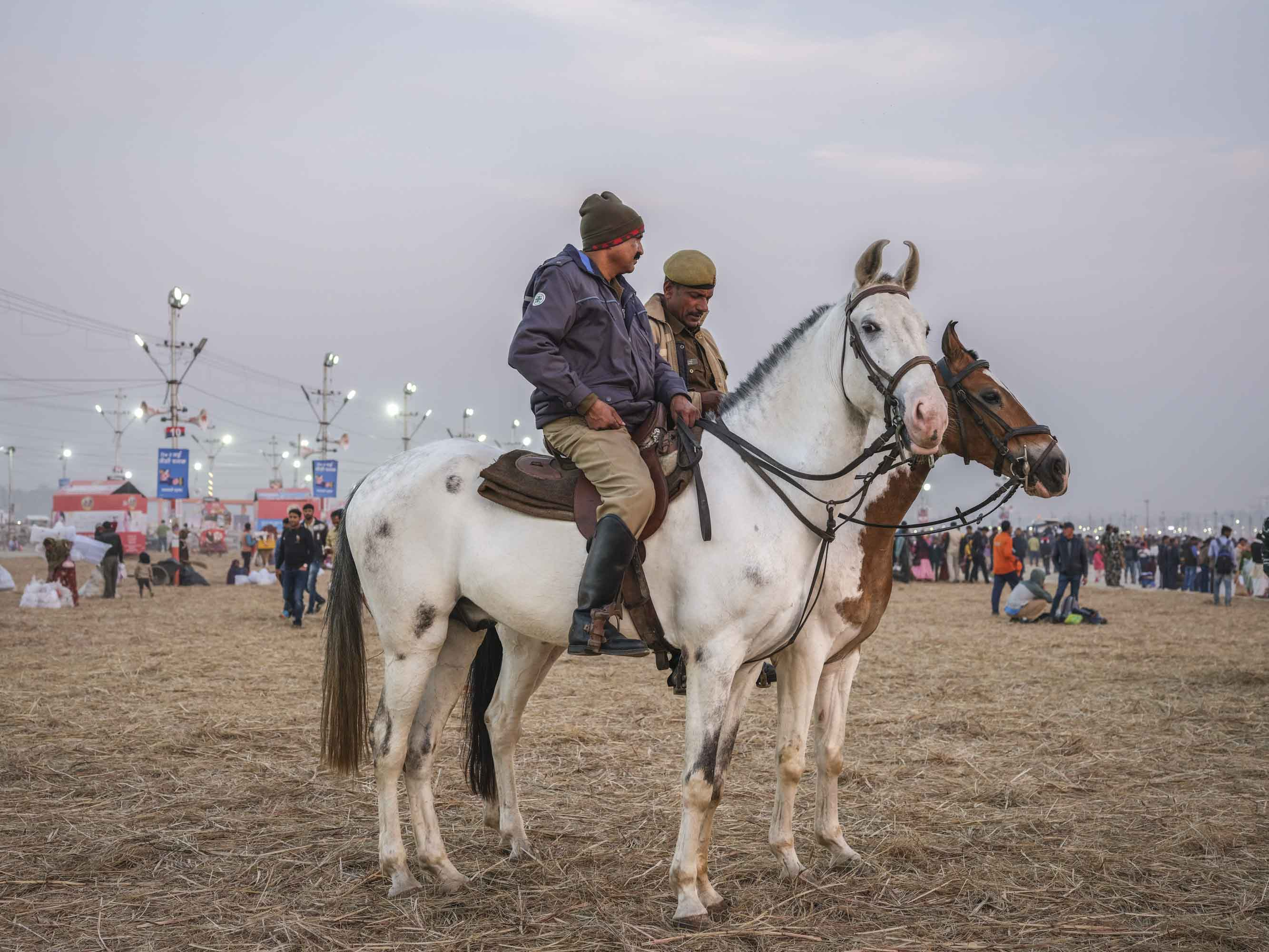 policeman army military on horses pilgrims Kumbh mela 2019 India Allahabad Prayagraj Ardh hindu religious Festival event rivers photographer jose jeuland photography