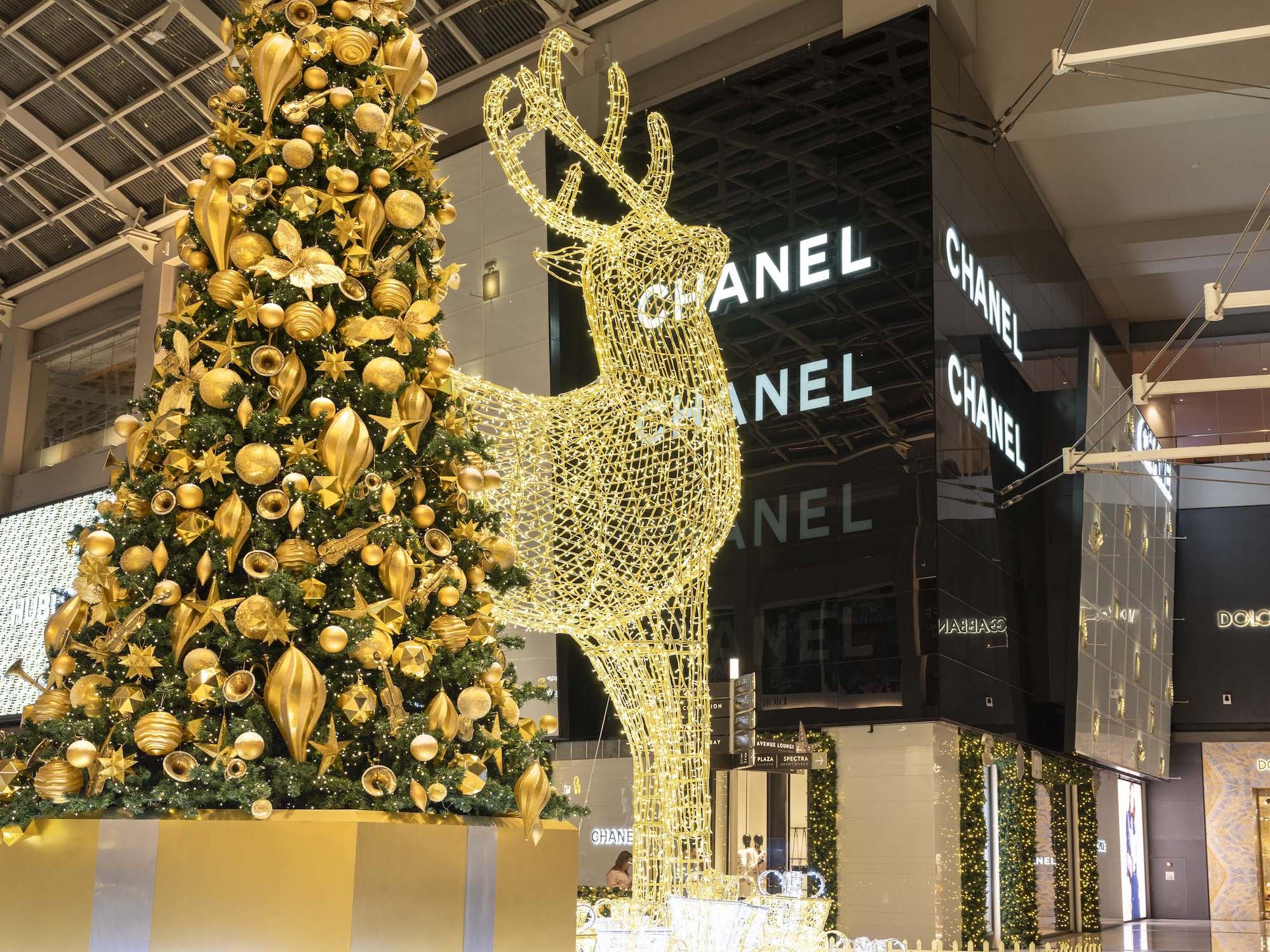 Marina Bay Sands Interior Photography by Jose Jeuland Christmas Tree and Reindeer side by side beside Chanel store