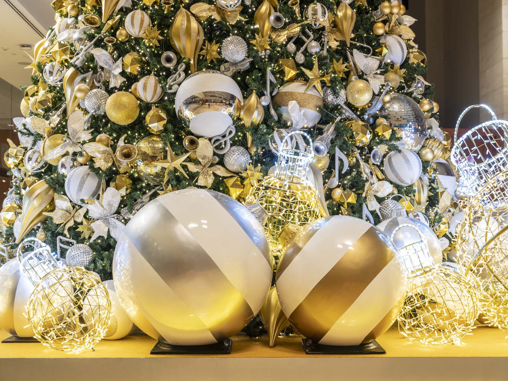 Marina Bay Sands Interior Photography by Jose Jeuland Golden ball ornaments under the Christmas tree