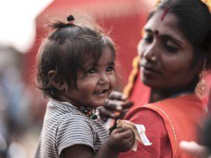baby smiling Gypsy Kalbelia tribe nomad Rajasthan India Documentary Photography Jose Jeuland Photographer print fine art