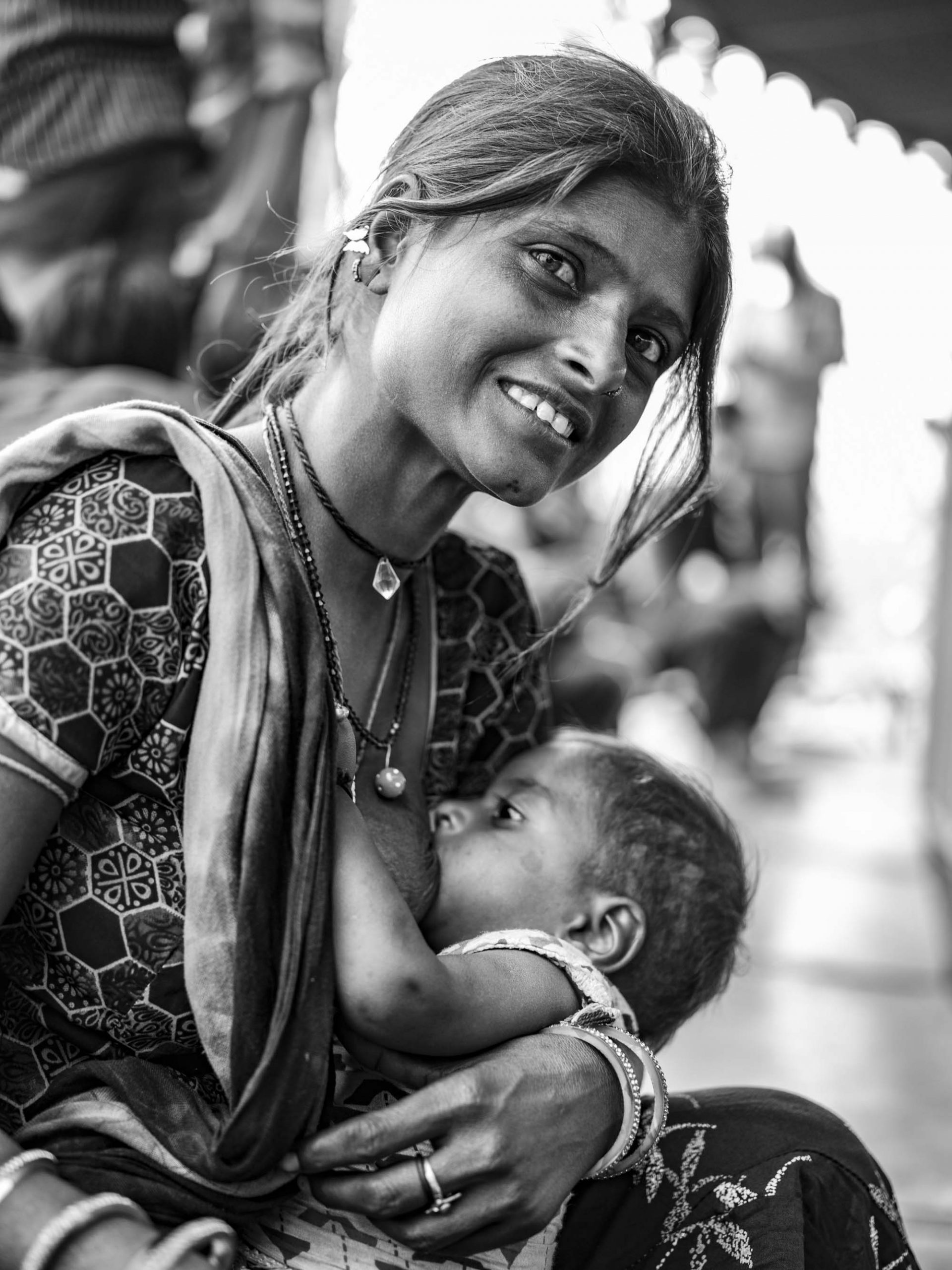 mother giving milk Gypsy Kalbelia tribe nomad Rajasthan India Documentary Photography Jose Jeuland Photographer print fine art
