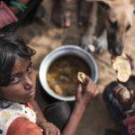 kid eaten and dog Gypsy Kalbelia tribe nomad Rajasthan India Documentary Photography Jose Jeuland Photographer print fine art