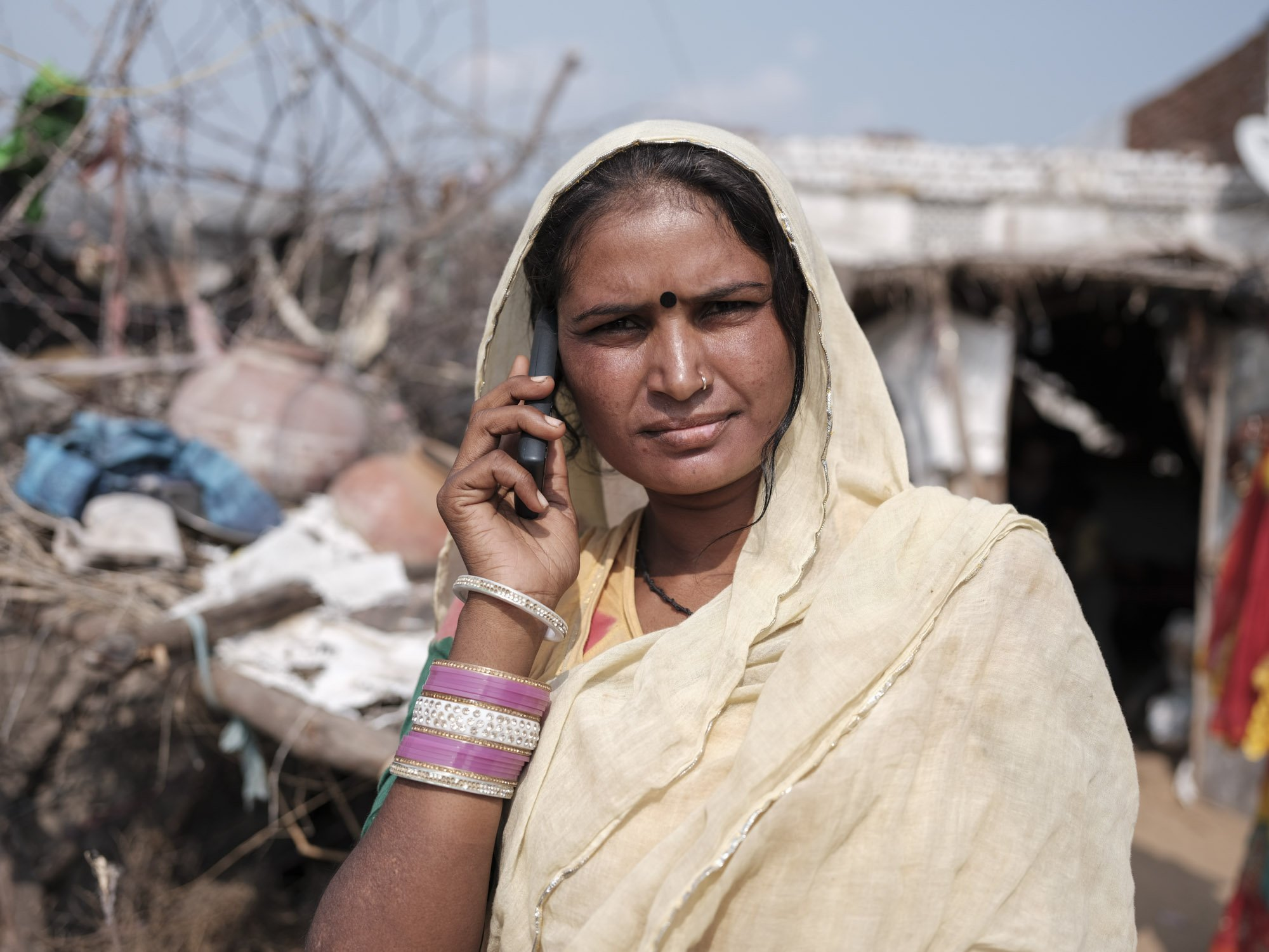 Indian lady on phone Gypsy Kalbelia tribe nomad Rajasthan India Documentary Photography Jose Jeuland Photographer print fine art