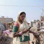 woman Indian phone Gypsy Kalbelia tribe nomad Rajasthan India Documentary Photography Jose Jeuland Photographer print fine art